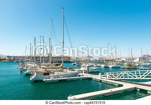 Few yachts in the habror, city background, Spain - csp44151515
