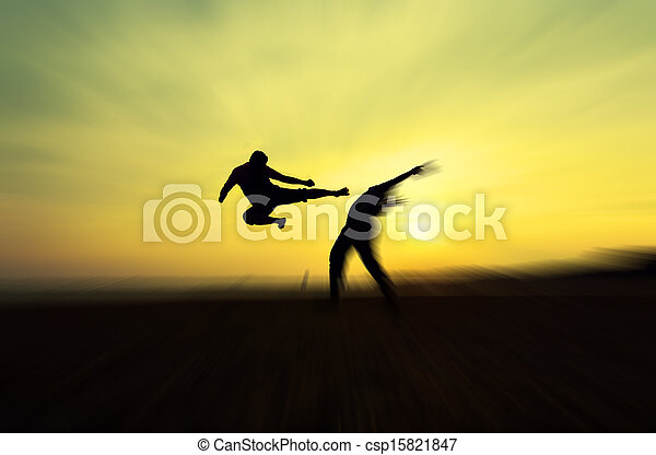 Fighting an enemy near the beach when the sun goes down - csp15821847