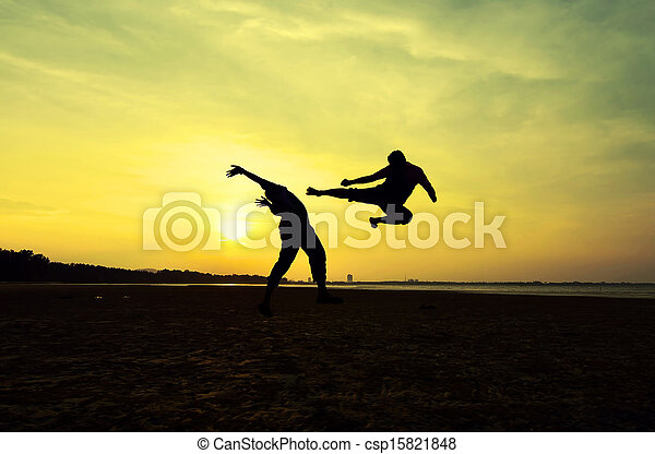Fighting an enemy near the beach when the sun goes down - csp15821848