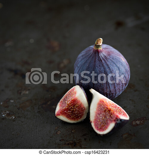 Figs on rustic table in dark tones - csp16423231