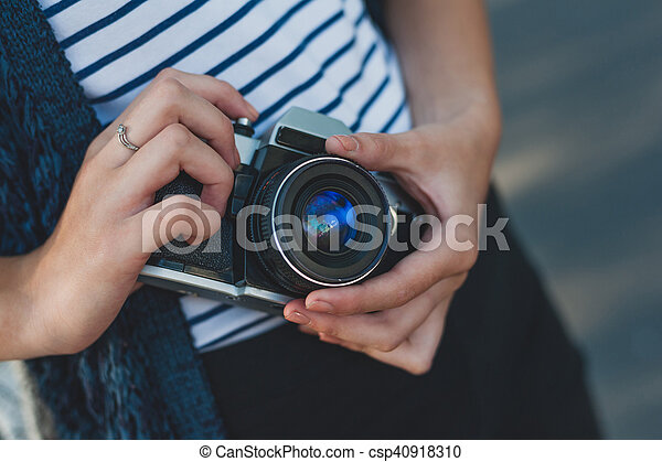 Film camera in the hands of the girl - csp40918310