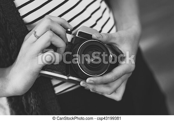 Film camera in the hands of the girl - csp43199381