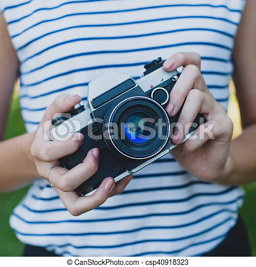 Film camera in the hands of the girl - csp40918323