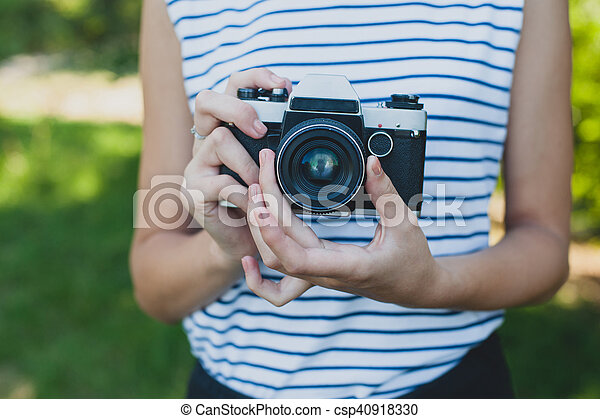 Film camera in the hands of the girl - csp40918330
