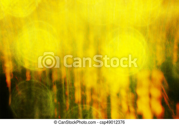 Film effect  Defocused flowers and grass for background  Blurred and de  focused fresh yellow blossom and green stalks leaves