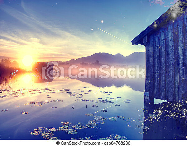 Filtered. Old wooden ship house at scenic Lake. Silent bay - csp64768236