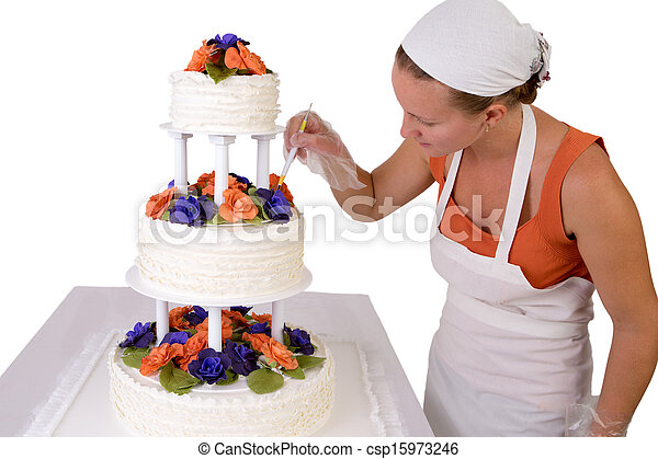 Final Touch ups on Ruffled Wedding Cake - csp15973246