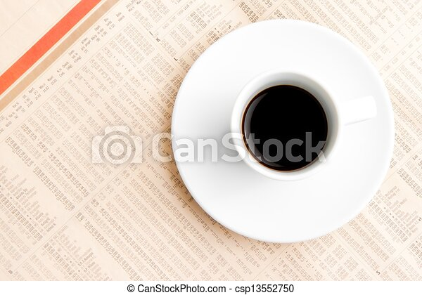 financial newspaper and cup of coffee - csp13552750