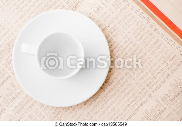 financial newspaper and empty cup of coffee - csp13565549
