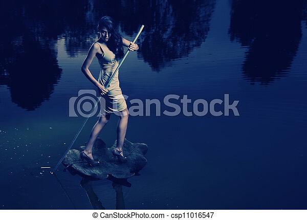 Fine art image of a woman sailing a leaf - csp11016547