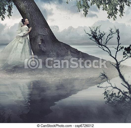 Fine art photo of a woman in beauty scenery - csp6726012