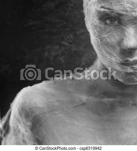 Fine art photo of a young beauty's face wrapped with bandage - csp6319942
