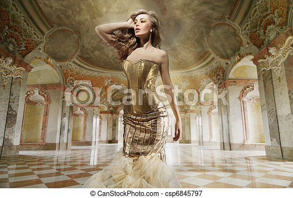 Fine art photo of a young fashion lady in a stylish interior - csp6845797