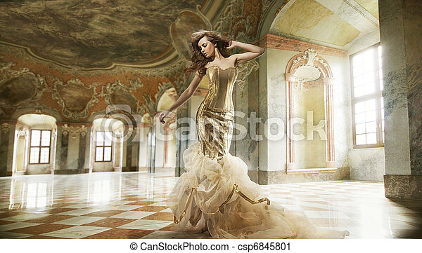 Fine art photo of a young fashion lady in a stylish interior - csp6845801
