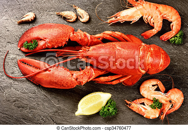 Fine selection of crustacean for dinner. Lobster and shrimps on stone plate - csp34760477