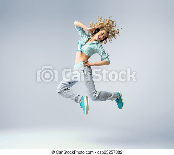 Fine shot of a jumping woman - csp25257382