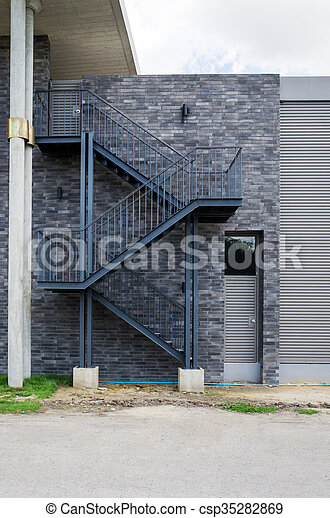 Fire Escape Staircase On The Brick Wall   Csp35282869