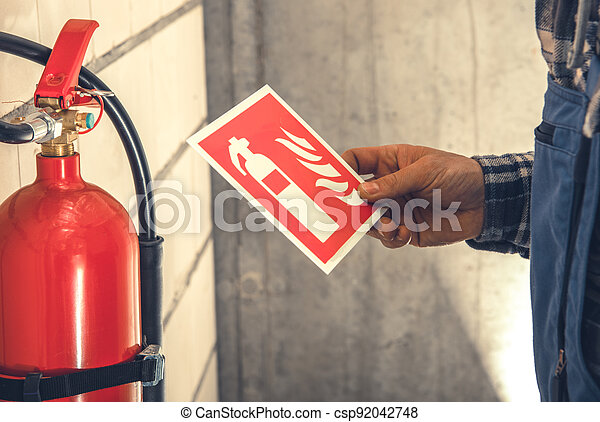 Fire Extinguisher Installation Inside Commercial Building - csp92042748