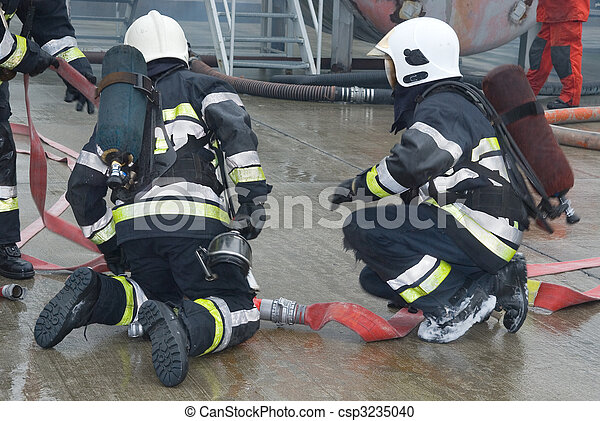 Fire fighters preparing hoses - csp3235040