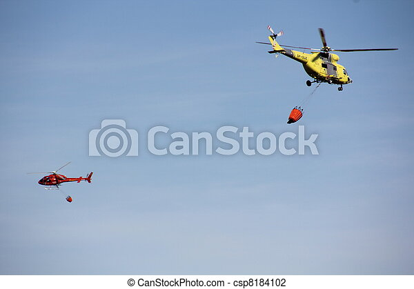 fire fighting helicopters fire on the mountain - csp8184102