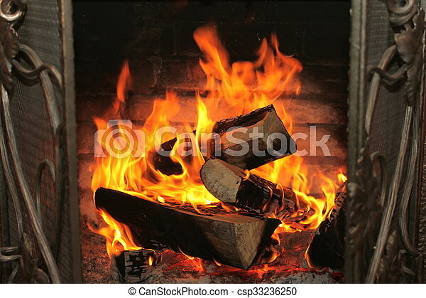 Fire in burning fireplace in winter - csp33236250