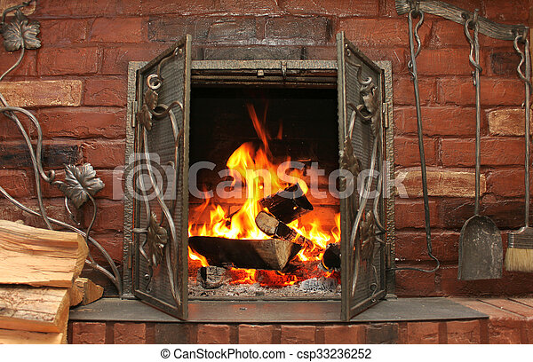 Fire in burning fireplace in winter - csp33236252