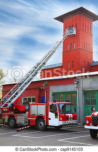 fire station, red fire truck with long ladder, red high tower - csp9145103
