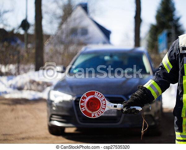 Firefighter blocks the road - csp27535320