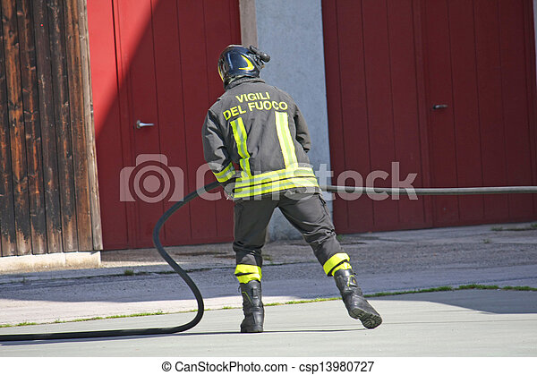 firefighter in action during a fire with the water hose - csp13980727