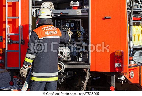 Firefighter on fire truck - csp27535295