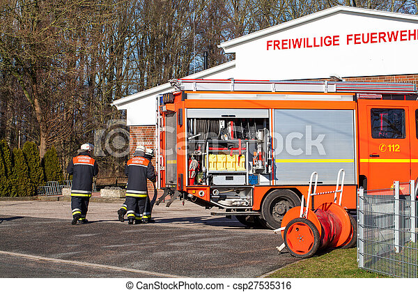 Firefighter using Emergency Vehicle - csp27535316