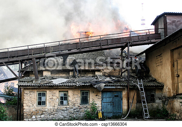 firefighters extinguish a fire in an apartment house - csp13666304