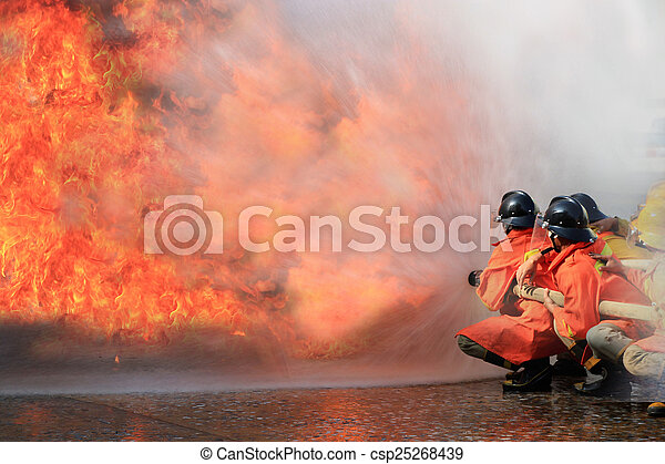 Firefighters fighting fire during training - csp25268439