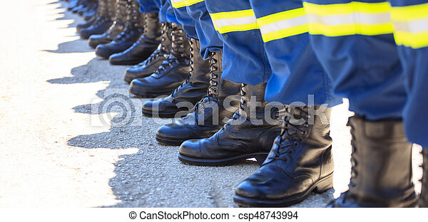Firefighters in their uniforms standing in line - csp48743994