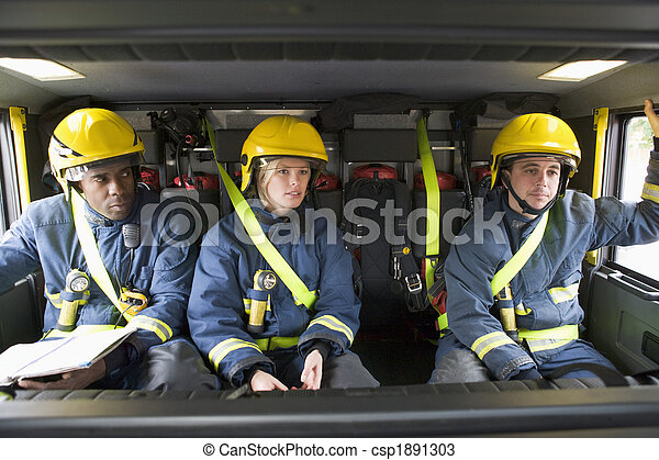 Firefighters on their way to an emergency scene - csp1891303