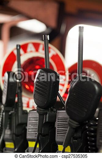 Fireman radios in emergency vehicle - csp27535305