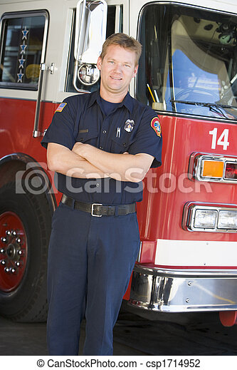Fireman standing in front of fire engine - csp1714952