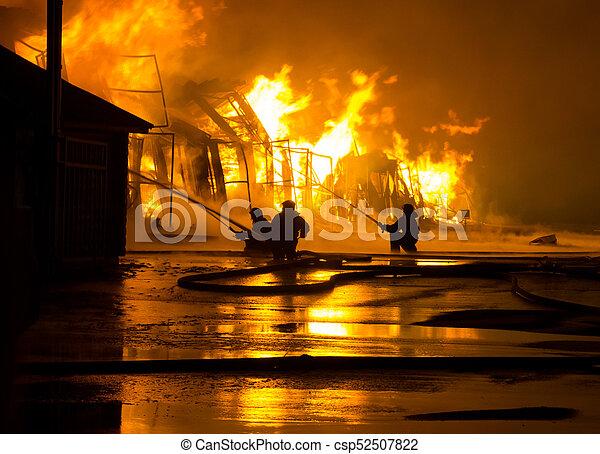 Firemen at work on fire - csp52507822