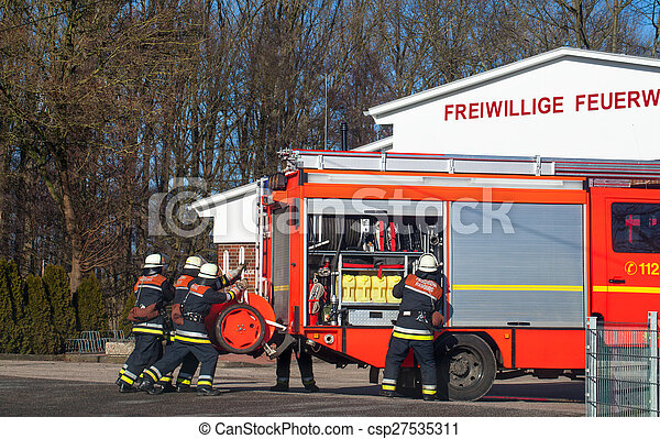 Firemen with emergency vehicle - csp27535311