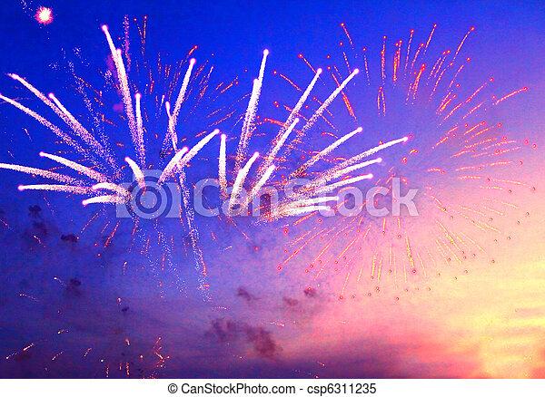 fireworks in evening sky - csp6311235