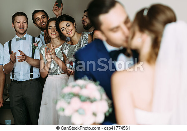 First kiss of the couple in the wedding day - csp41774561