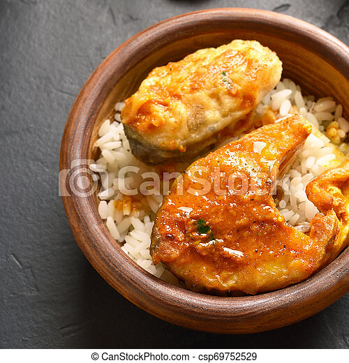 Fish curry with rice - csp69752529
