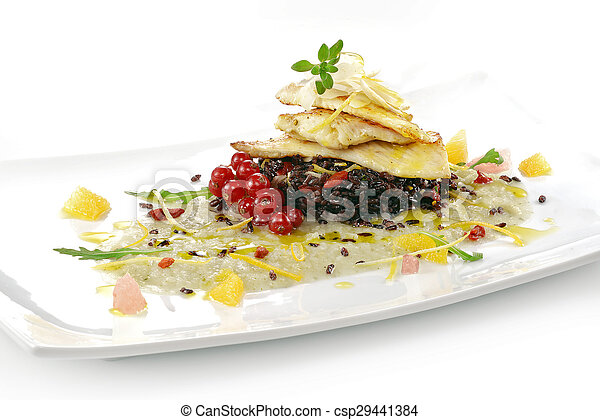 fish dish, turbot fillet with citrus, fennel cream, black rice, currants and goji berries - csp29441384