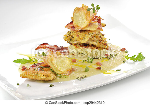 fish dish, turbot fillets flavored crust, cips, rosti, creamed potatoes, crispy bacon6 - csp29442310