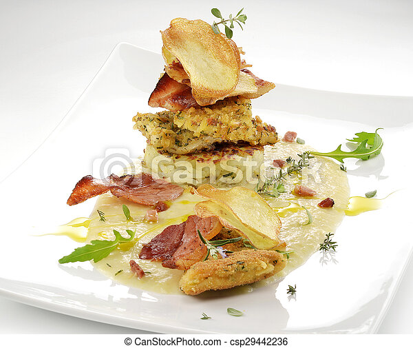fish dish, turbot fillets flavored crust, cips, rosti, creamed potatoes, crispy bacon5 - csp29442236