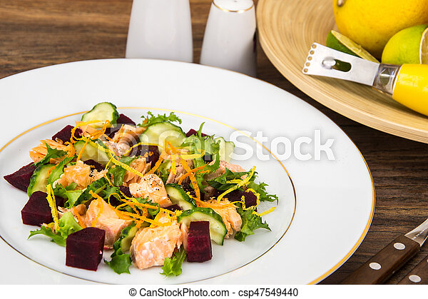 Fish dishes, salad with salmon and beets - csp47549440