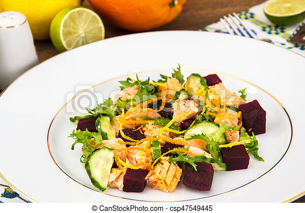 Fish dishes, salad with salmon and beets - csp47549445