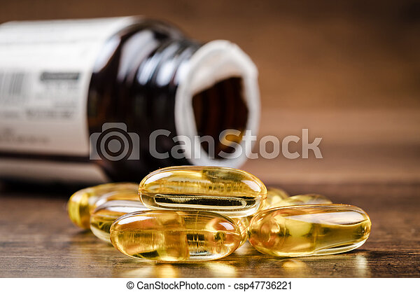 Fish oil capsules with omega 3 and vitamin D. - csp47736221