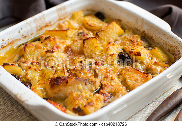 Fish with potatoes cooked in oven - csp40218726