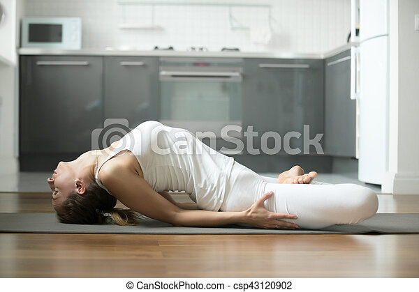 fish yoga pose sporty young attractive woman practicing